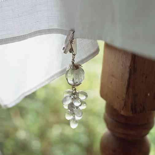 Elegante clip para sujetar el mantel de cristal