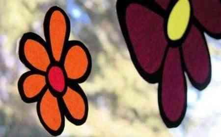 Flores de papel para decorar las ventanas