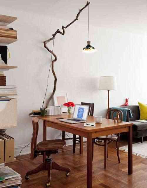 decoracion con rama de árbol - lámpara
