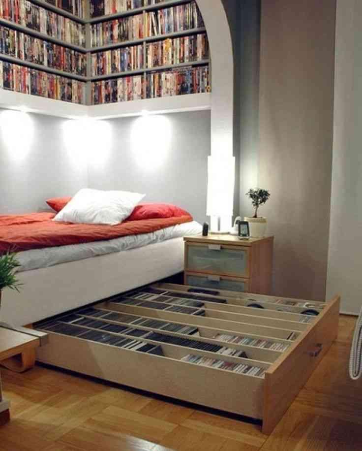 estantería de cds y dvds debajo de la cama