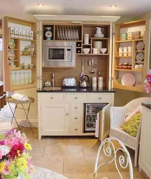 cocina en armario empotrado oculta