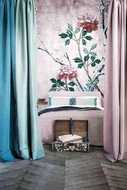 decorar dormitorios originales - pared pintada como cabecero de cama