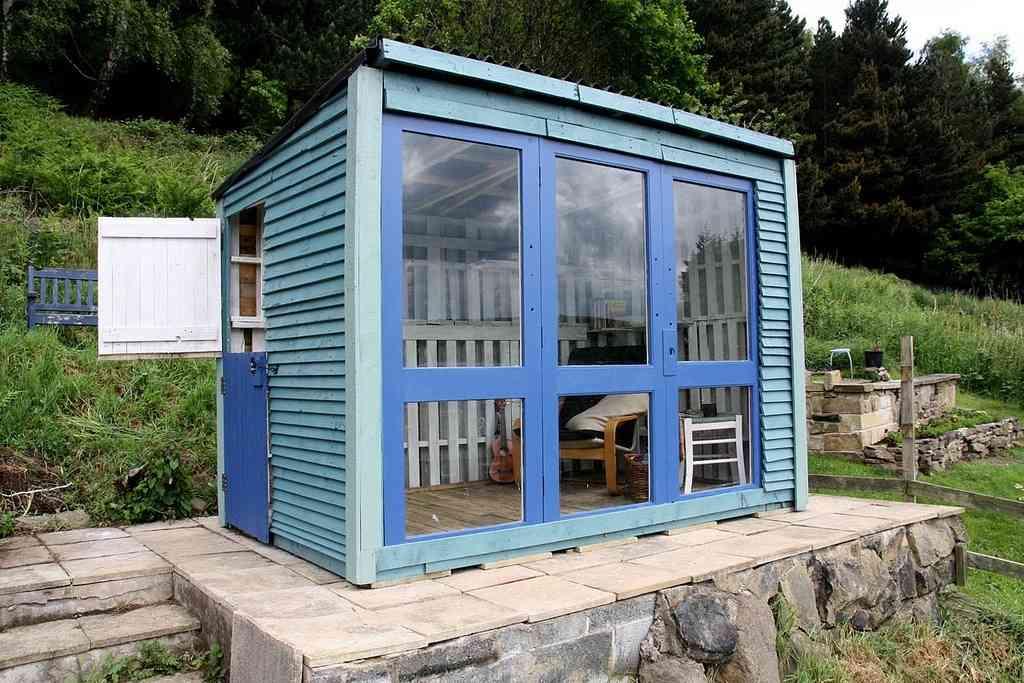 Idea para reciclar palets con una caseta madera for Casetas de patio