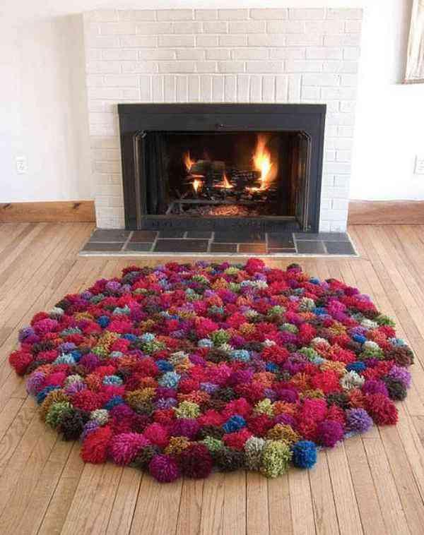 cálida alfombra de pompones