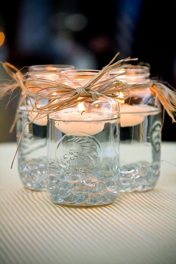 utilizar tarros de cristal - velas flotantes en un jarrón