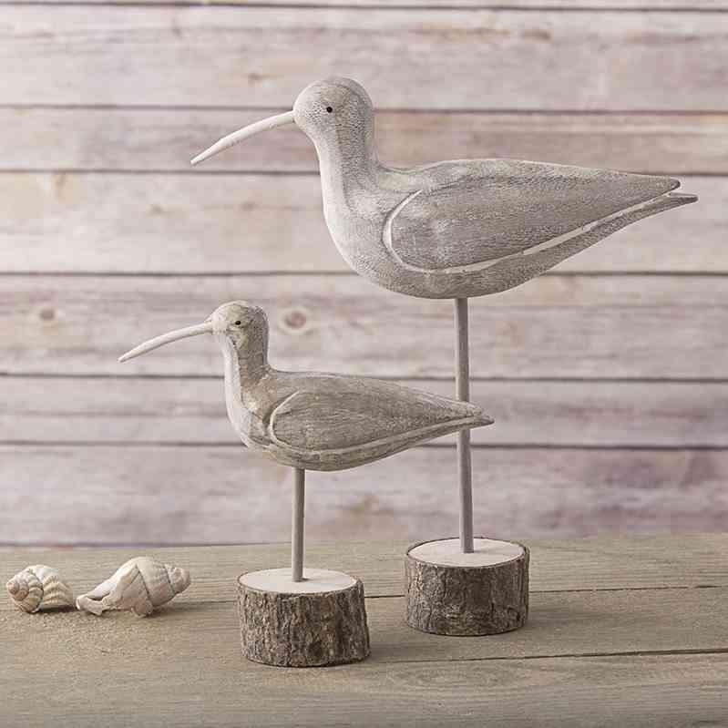 decoracion de una casa de playa pajaros de madera