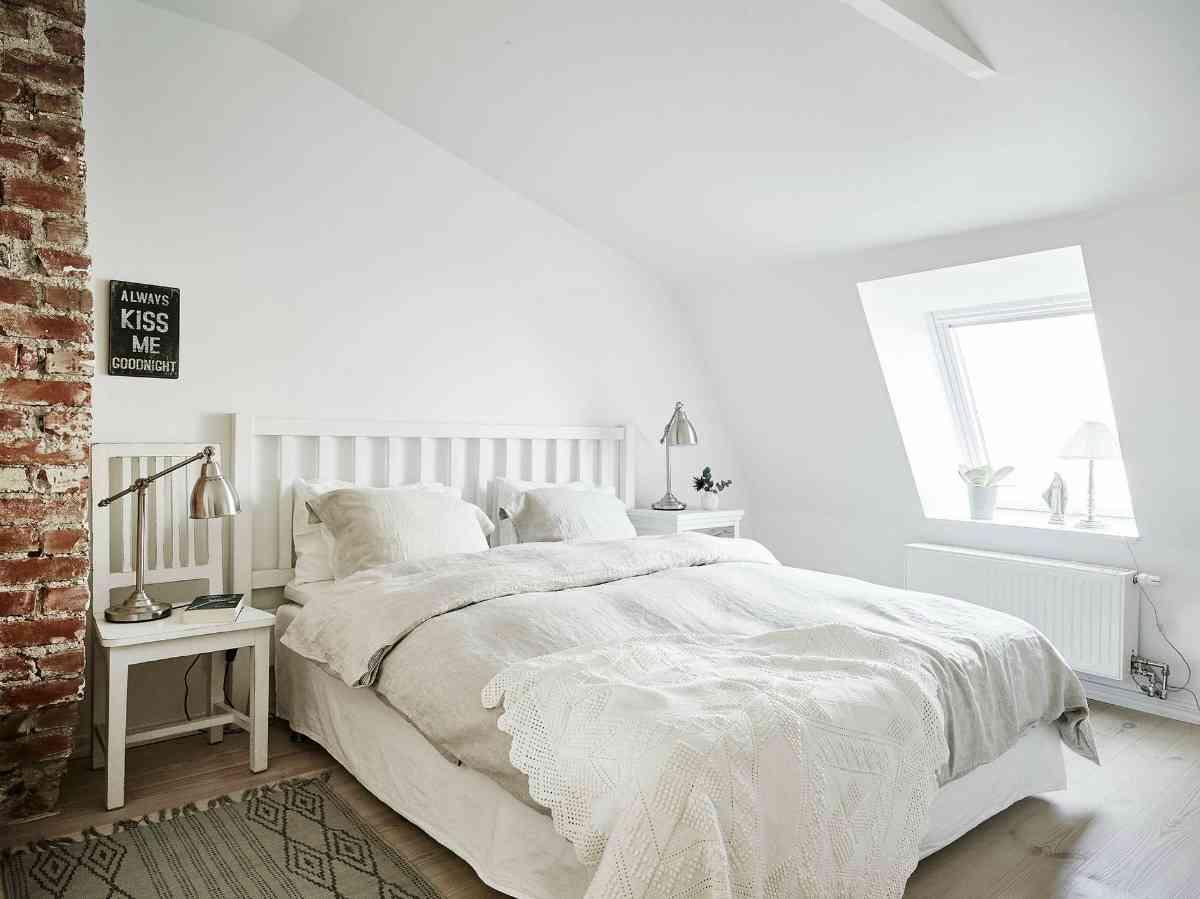 Ático de estilo nórdico dormitorio 1200x899