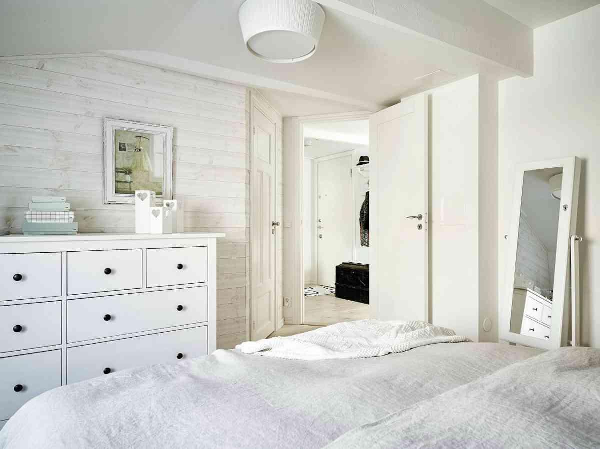 Ático de estilo nórdico dormitorio vista desde dentro 1200x899