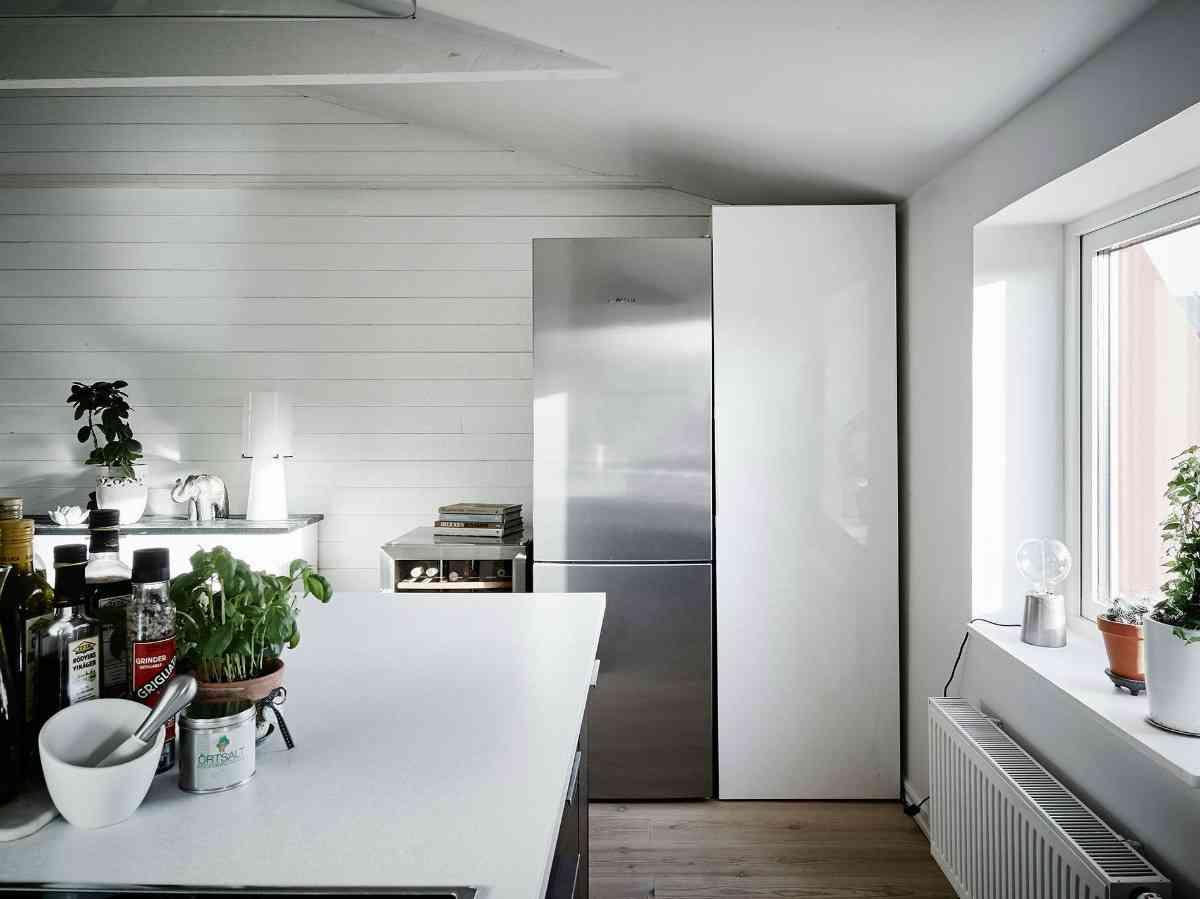 Ático de estilo nórdico vista salida de cocina 1200x899