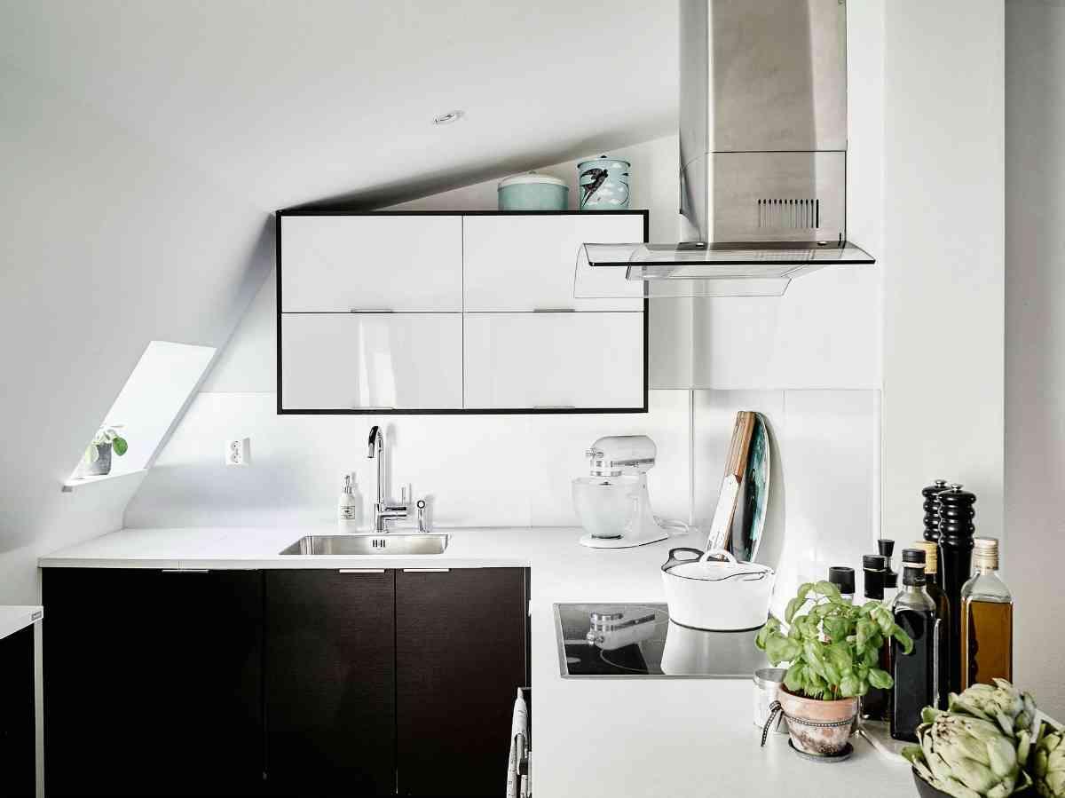 Ático de estilo nórdico zona cocción cocina 1200x899