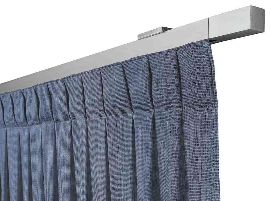 3 sistemas diferentes y pr cticos para colgar cortinas en casa for Ganchos para colgar cortinas