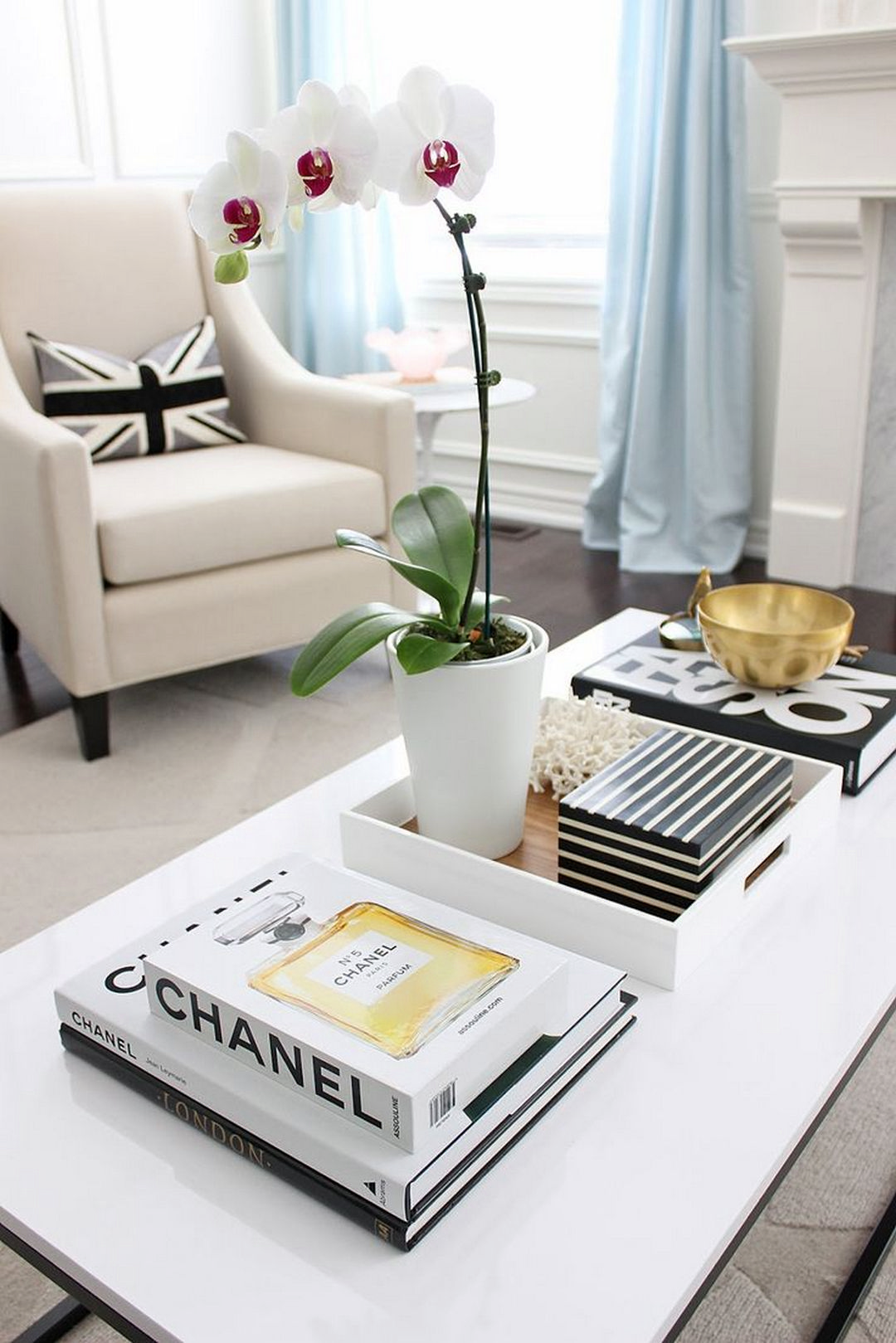 Coffee tables with stacked books