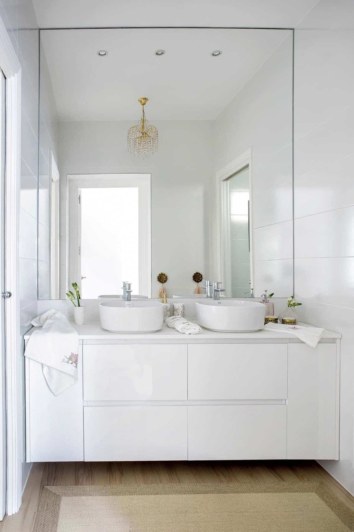 Bathroom mirrors with white furniture