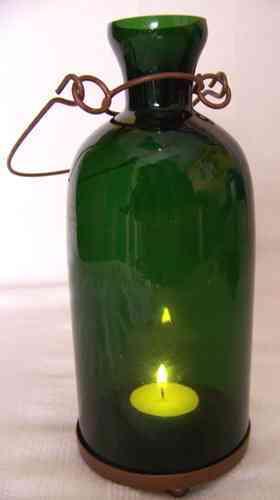 botella verde vela brujula sur