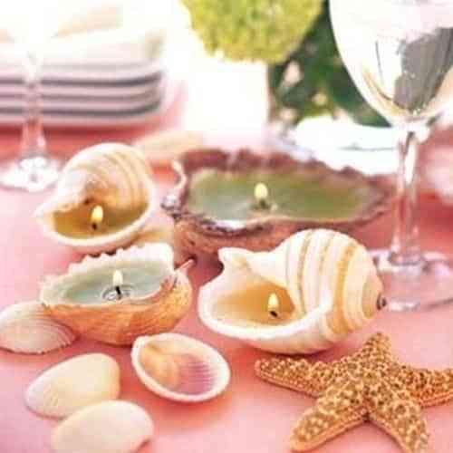 Realiza unas velas decorativas con conchas de caracoles
