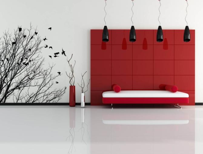 dormitorio decorado con un panel en rojo y un fondo blanco sobre el que han puesto un vinilo negro