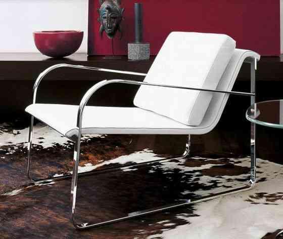 Sillones giratorios modernos sillon moderno cromado for Sillones cama modernos