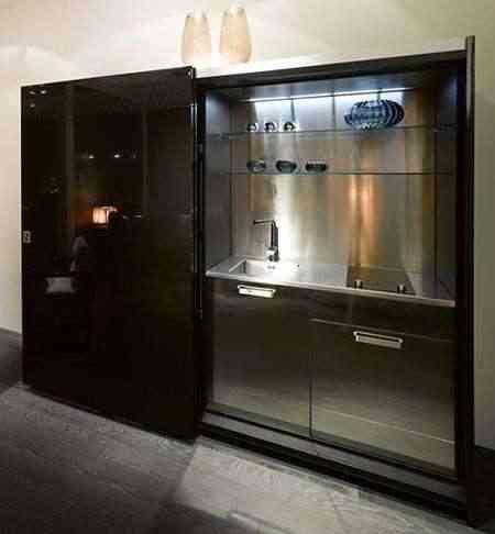 Cocina oculta para oficinas de casa fendi for Modelos de oficinas pequenas